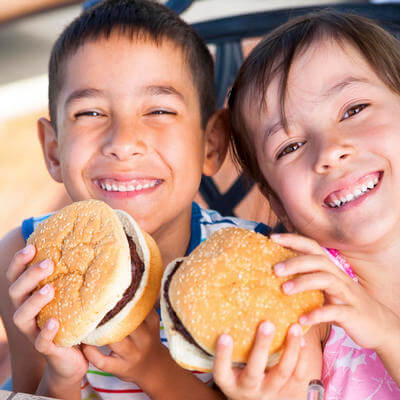 two kids holding their hamburgers