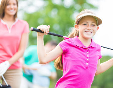 girl holding golf club