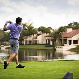 man in his backswing playing golf at grand cypress
