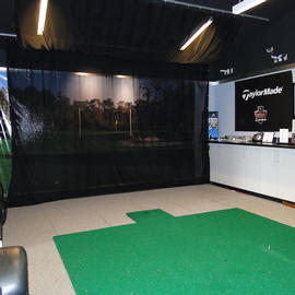indoor golf simulator at the villas at grand cypress