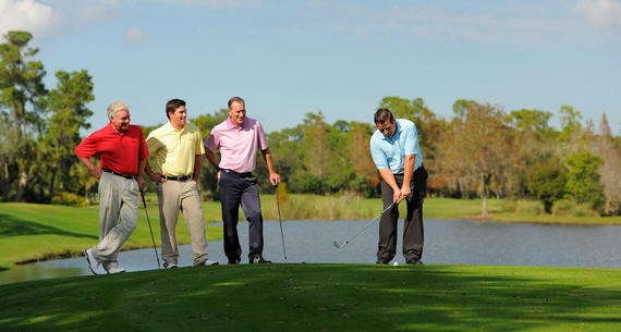 group of men chipping on the golf course at grand cypress