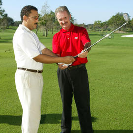 man showing another man his golf club