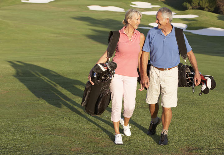 Couple Golfing at The Villas of Grand Cypress in Orlando, Florida