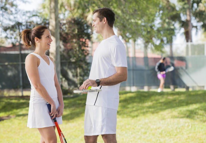couple playing tennis at grand cypress