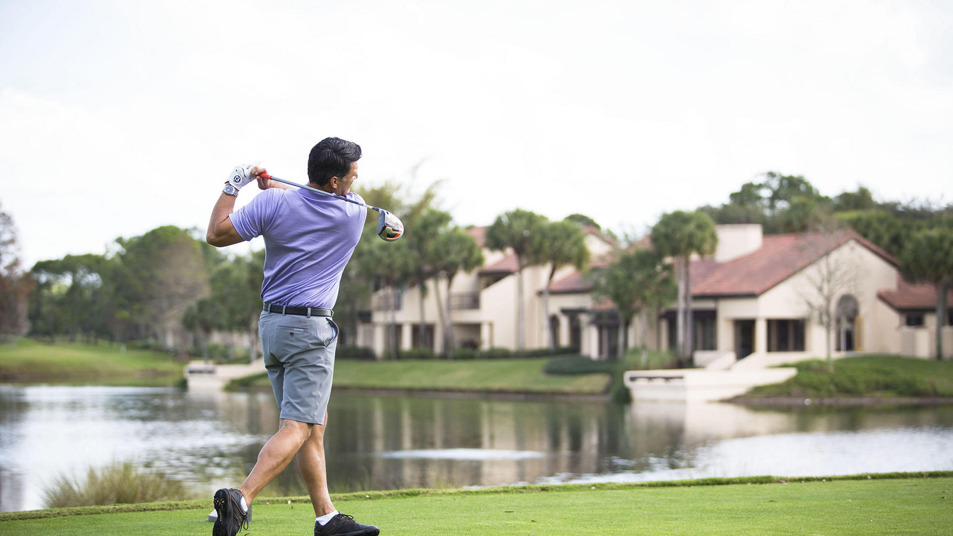 man Teeing Off at The Villas of Grand Cypress in Orlando Florida