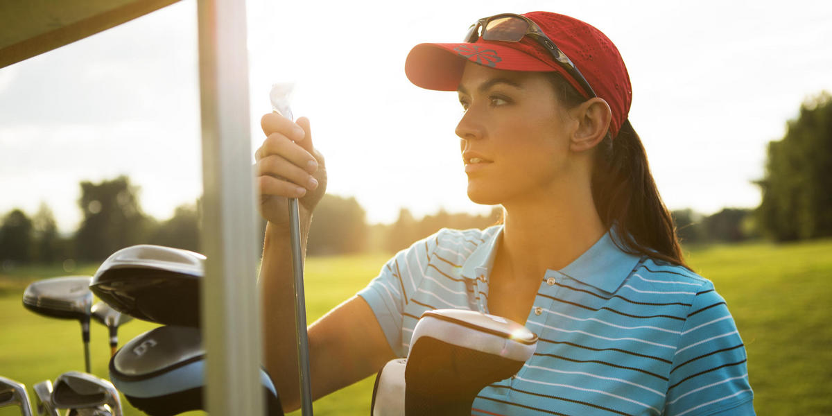 Woman holding golf club